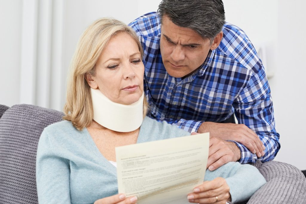 Injured woman and her husband reading a document