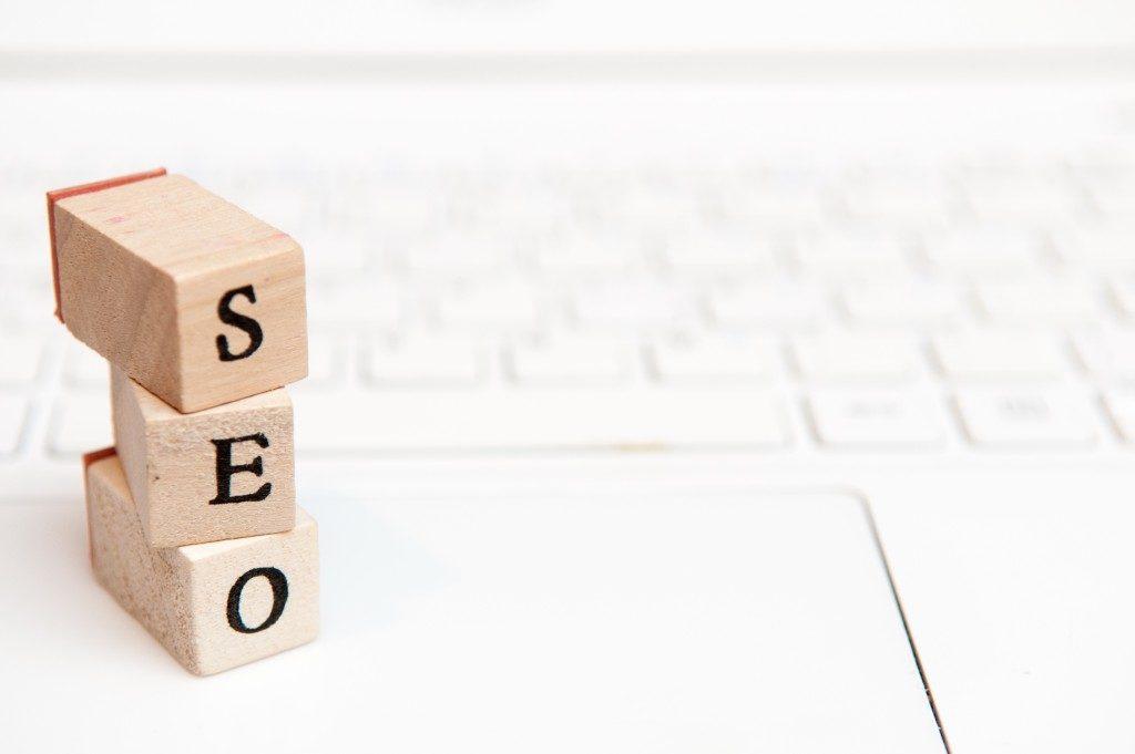 SEO Stamp blocks over laptop