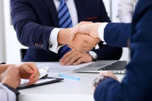 Business handshake at meeting or negotiation in the office