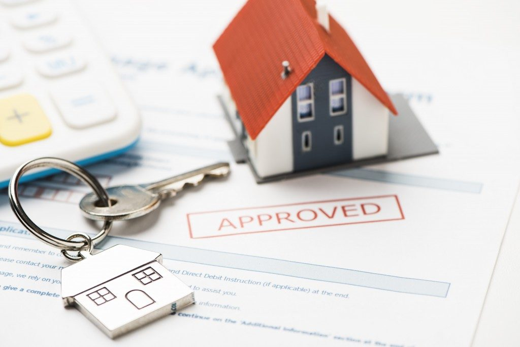 House keys and approved mortgage form