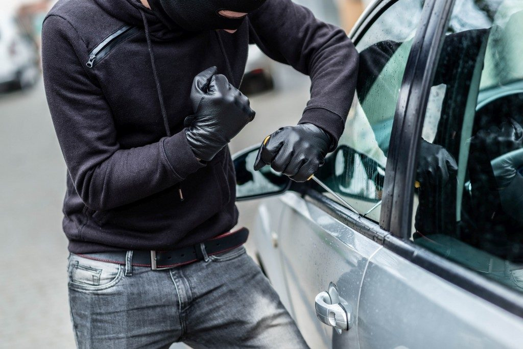 Thief attempting to steal a car