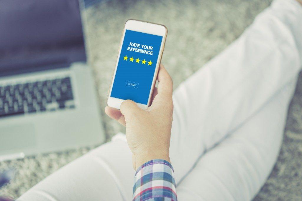 Customer satisfaction concept on smartphone screen