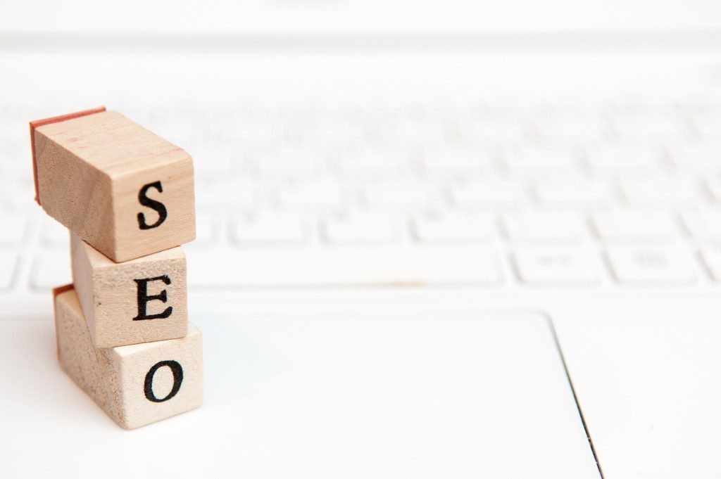 seo spelled in wooden small blocks