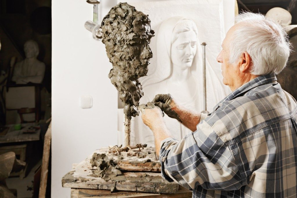 Artist creating a sculpture