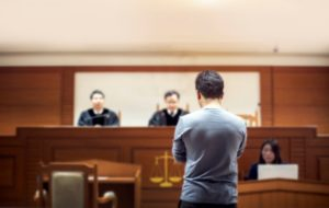 witness standing in a court room