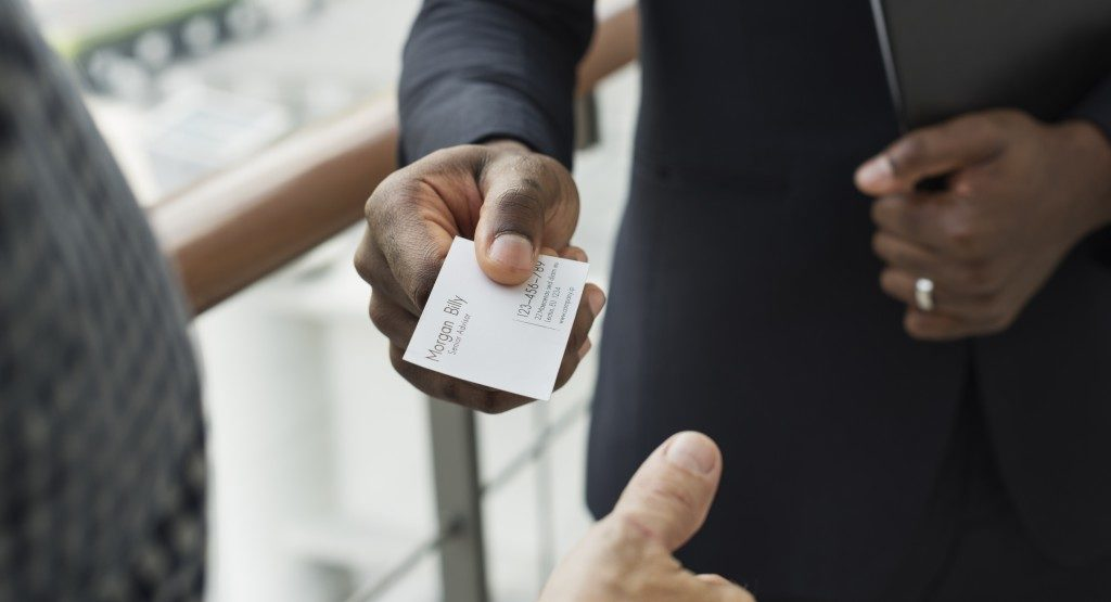 Man handing over his business card