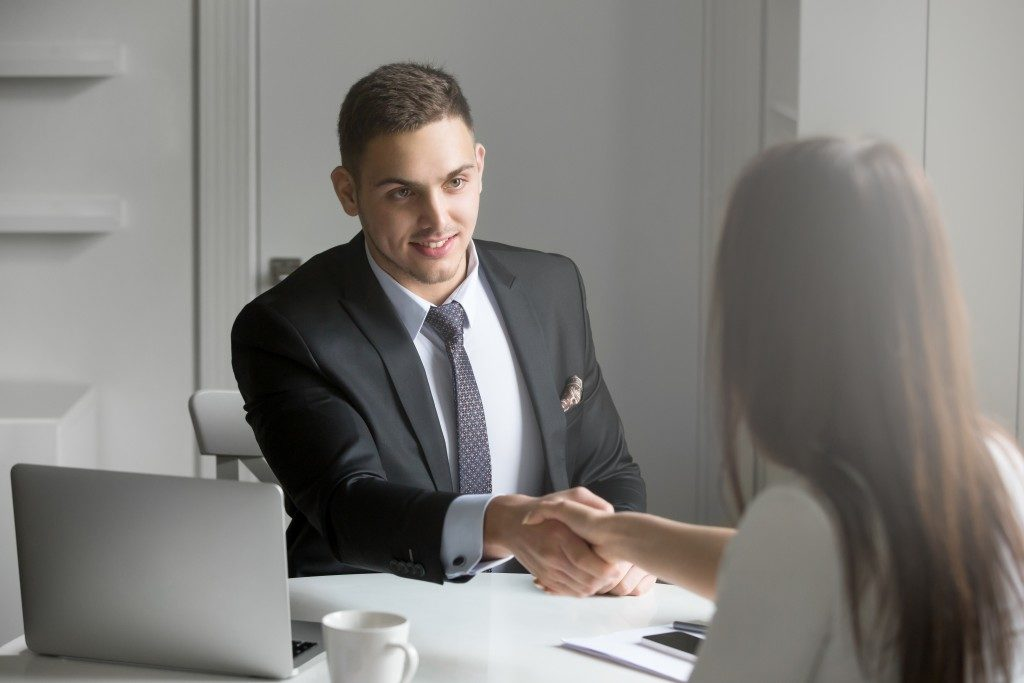 businessman shaking hands with a client during a meeting