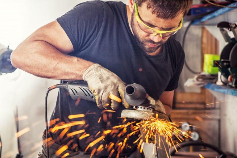 welder assembling a metal equipment