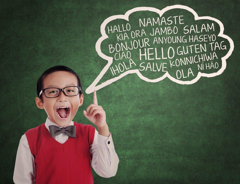 school boy learns to speak different language