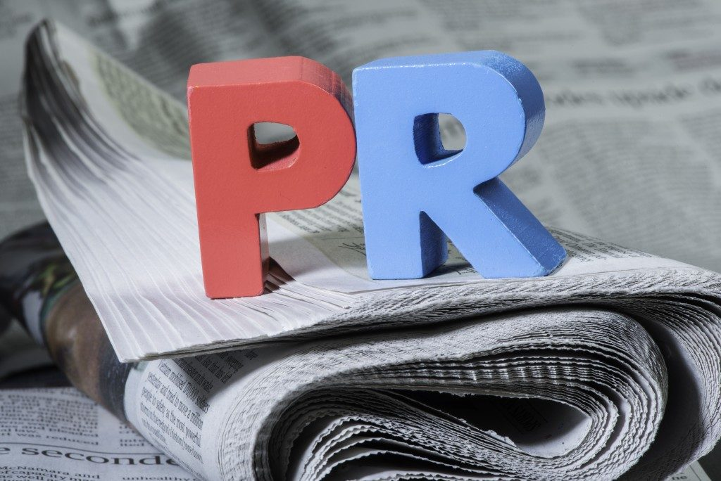 wooden PR letters on a newspaper