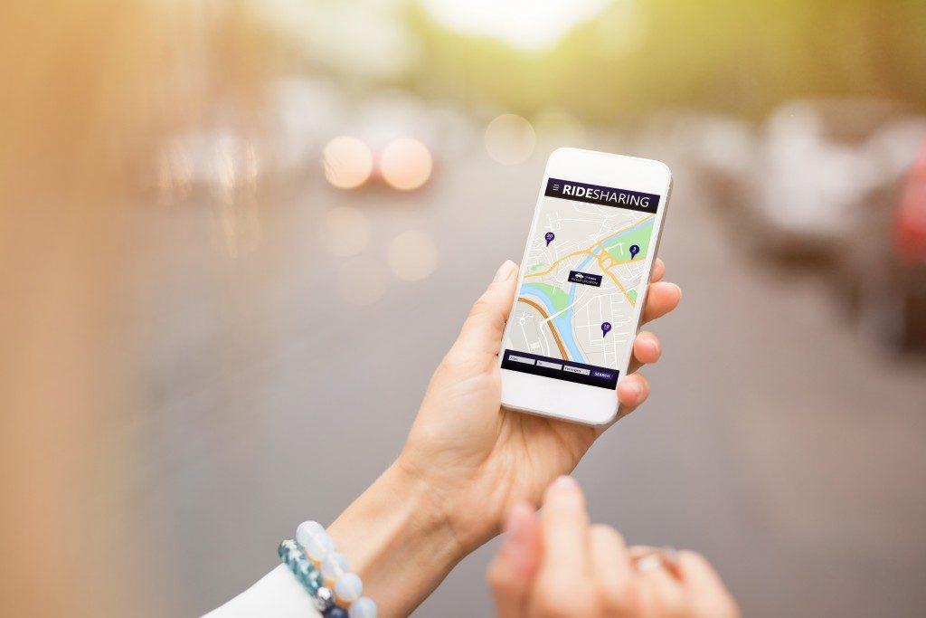 Woman using a ride sharing app
