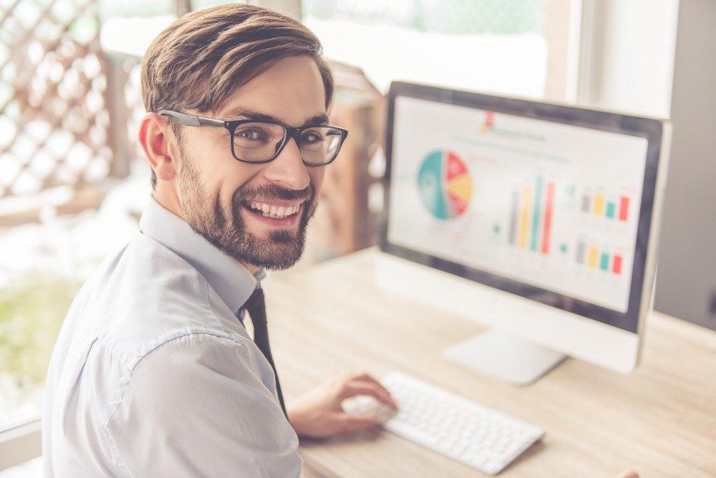 man using computer with analytics
