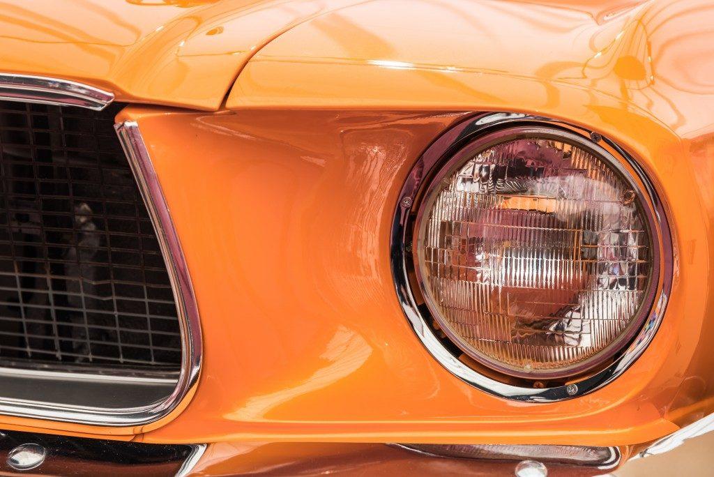 orange car, zoom in on headlights