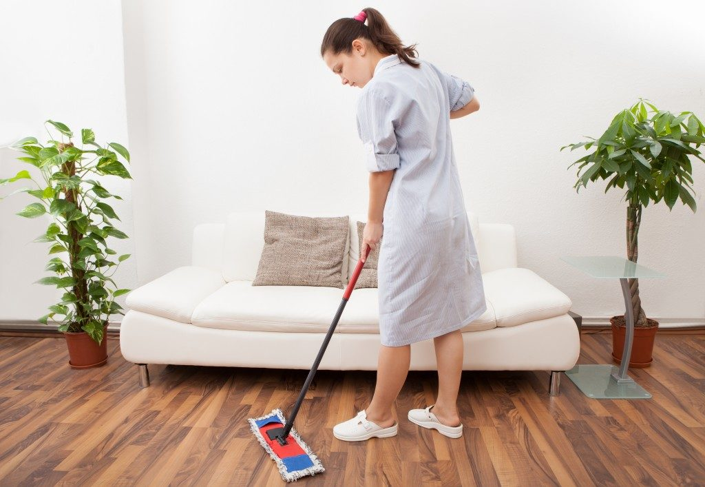 Maid mopping the floor
