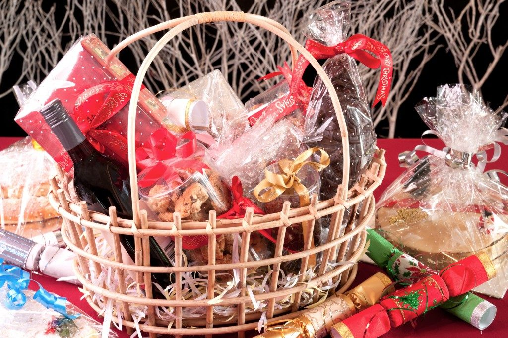 Christmas hamper basket with a chocolate Santa, cookies and a bottle of wine