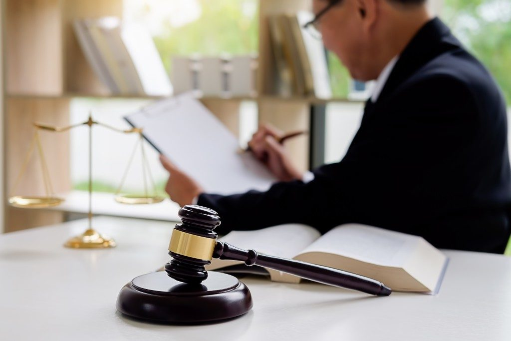 lawyer signing a document