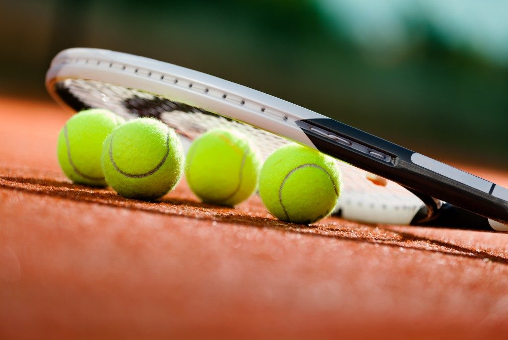 Tennis balls and racket