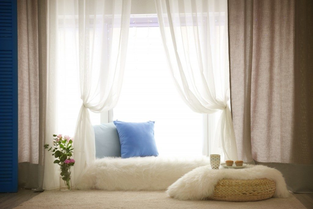 cozy couch beside the window