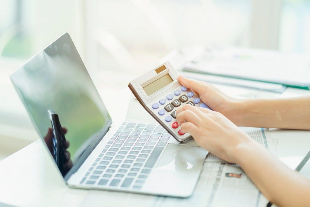 calculator in front of laptop