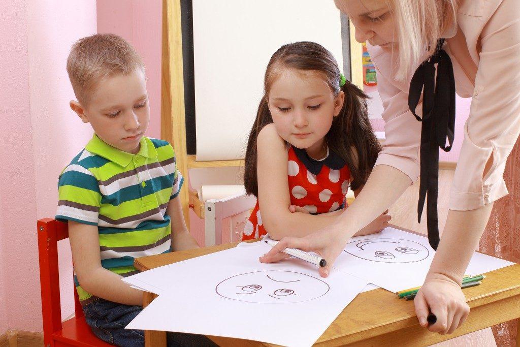 children being taught at school