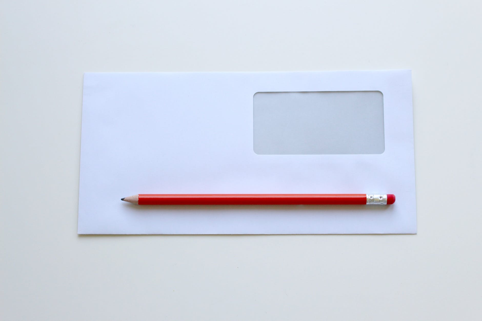 Envelope with red pencil