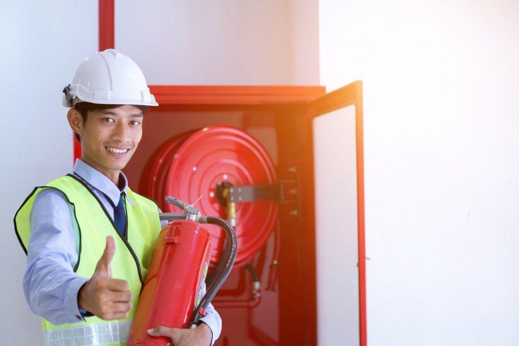 Man holding fire extinguisher