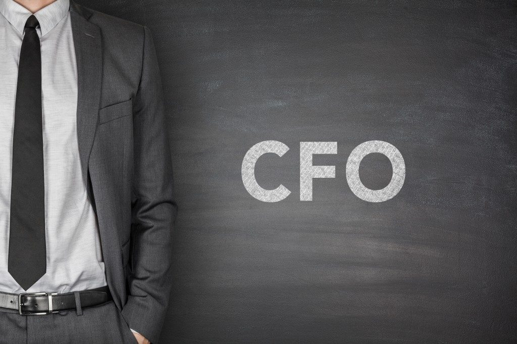 Businessman beside CFO letters