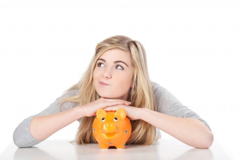Female with orange piggy bank