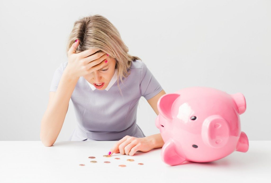 woman feeling problematic about money