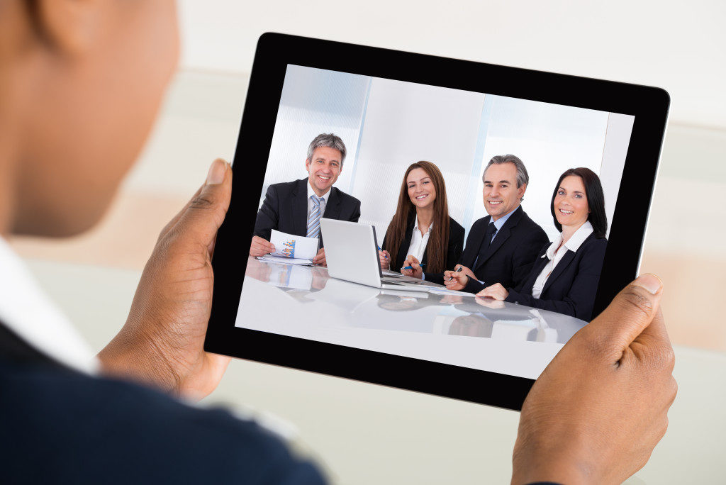 Close-up Of A Businesswoman Video Conferencing On Digital Tablet