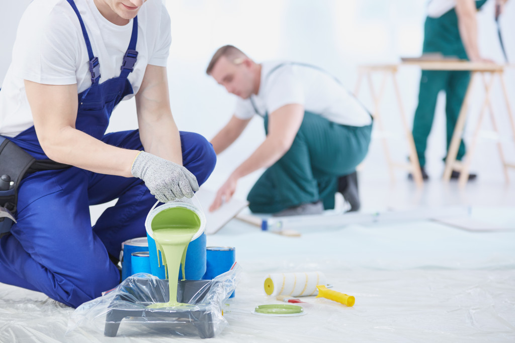 contractors pouring paint