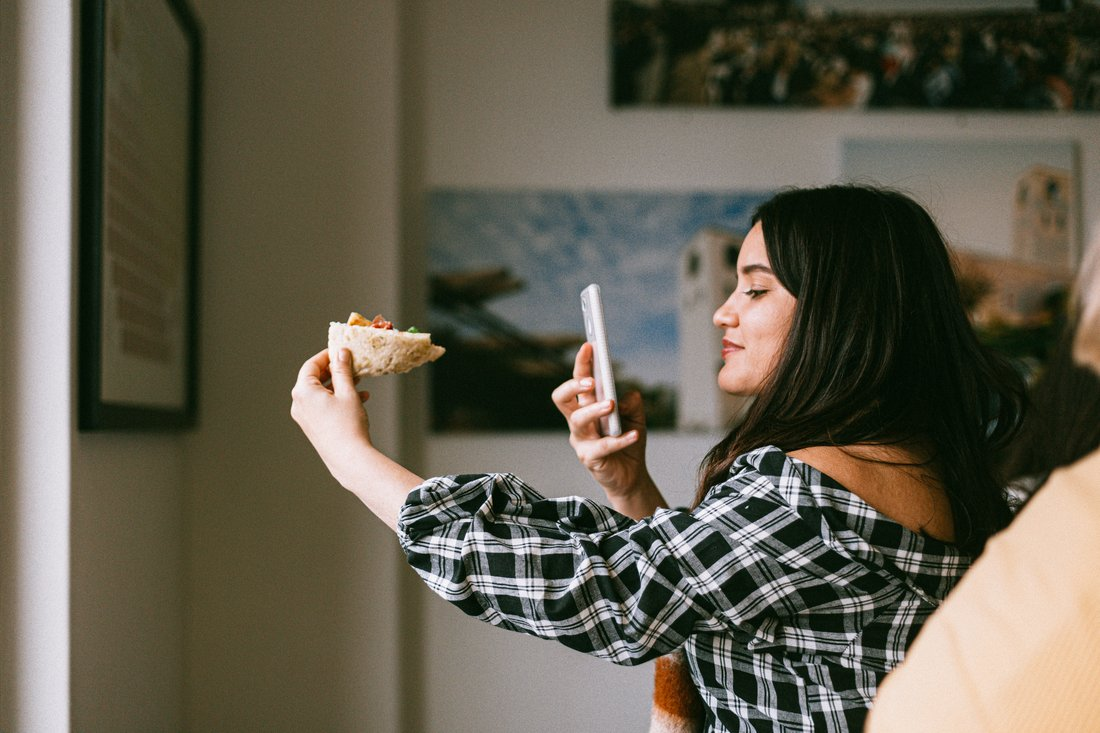 influencer taking photo of food