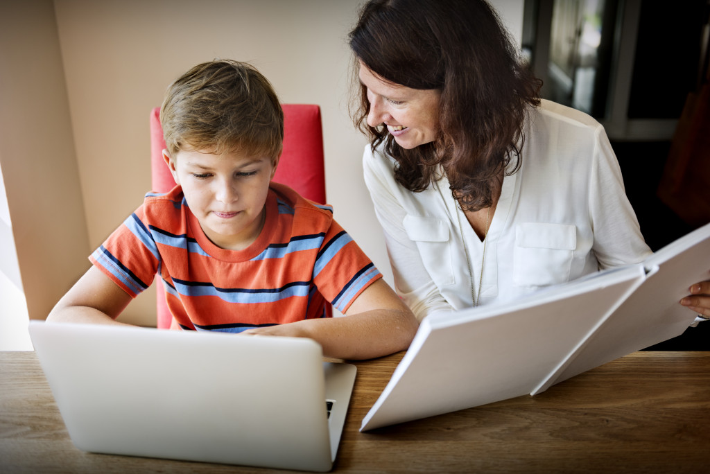 mother supervising child's online class
