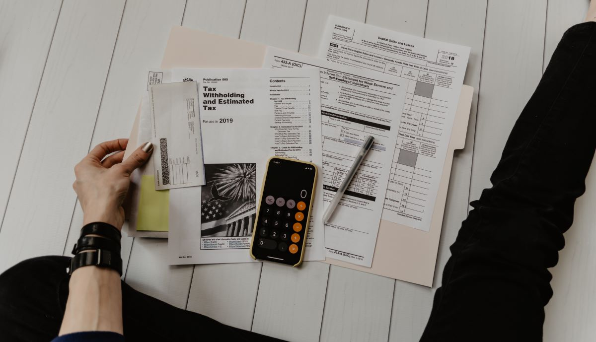 tax forms and phone calculator