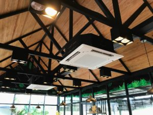 Ceiling type 4 directions air conditioning hanging in a bright glass windows coffee shop