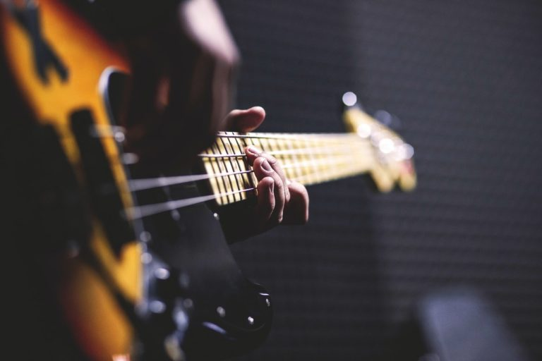 person playing the bass guitar