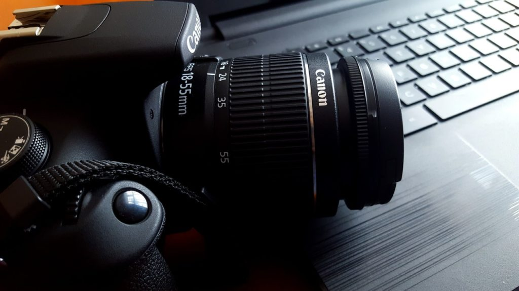 dslr camera on laptop