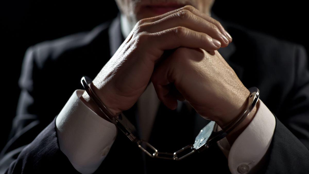 man hand cuffed
