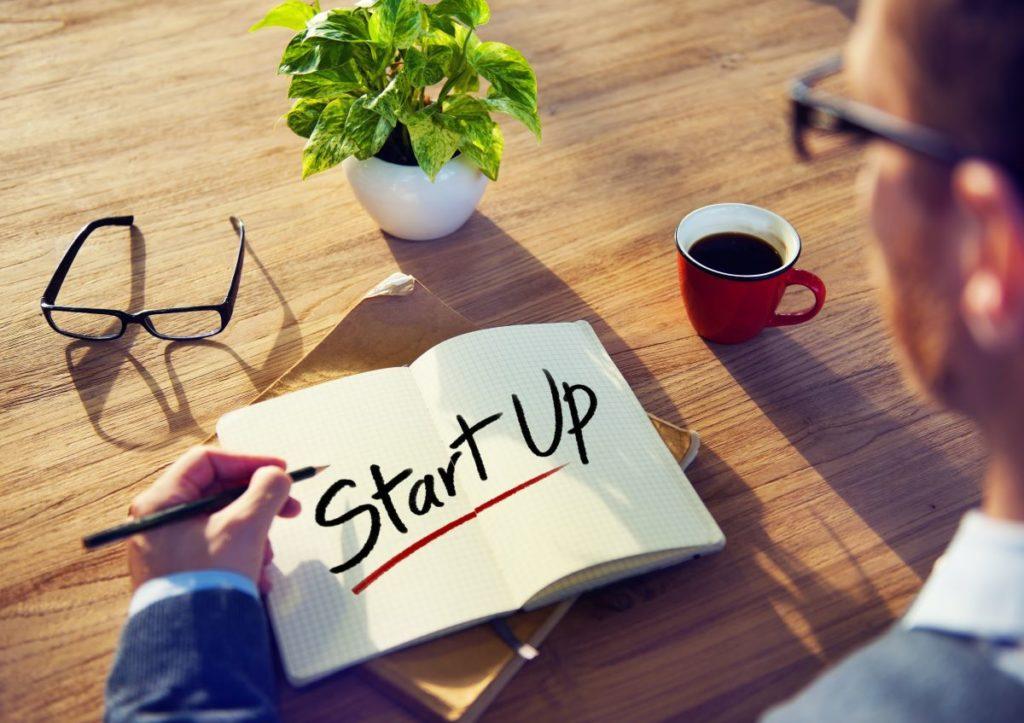 start up written on notebook