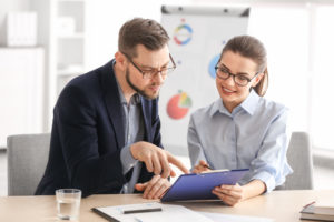 man consulting woman about work