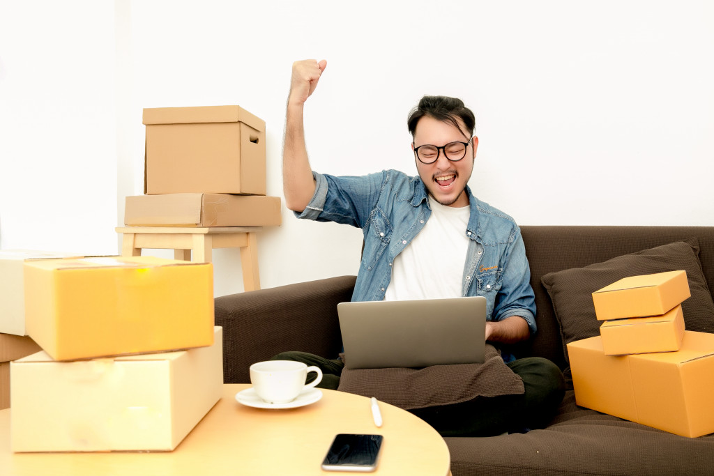 man celebrating with boxes