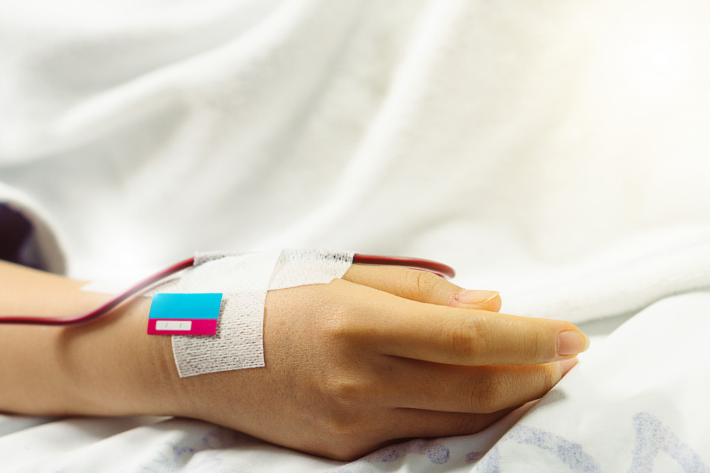 hand with a catheter tube for blood